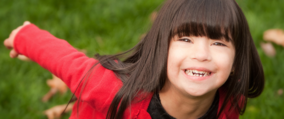 Emma.  Sparkling eyes and wonderful smile of a young girl with Down Syndrome.